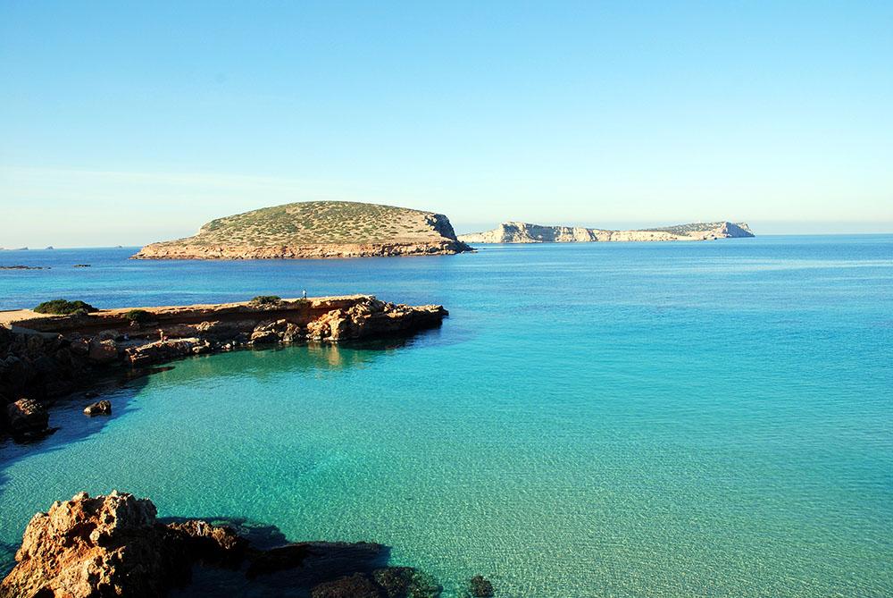 Ses salines beach Ibiza by boat