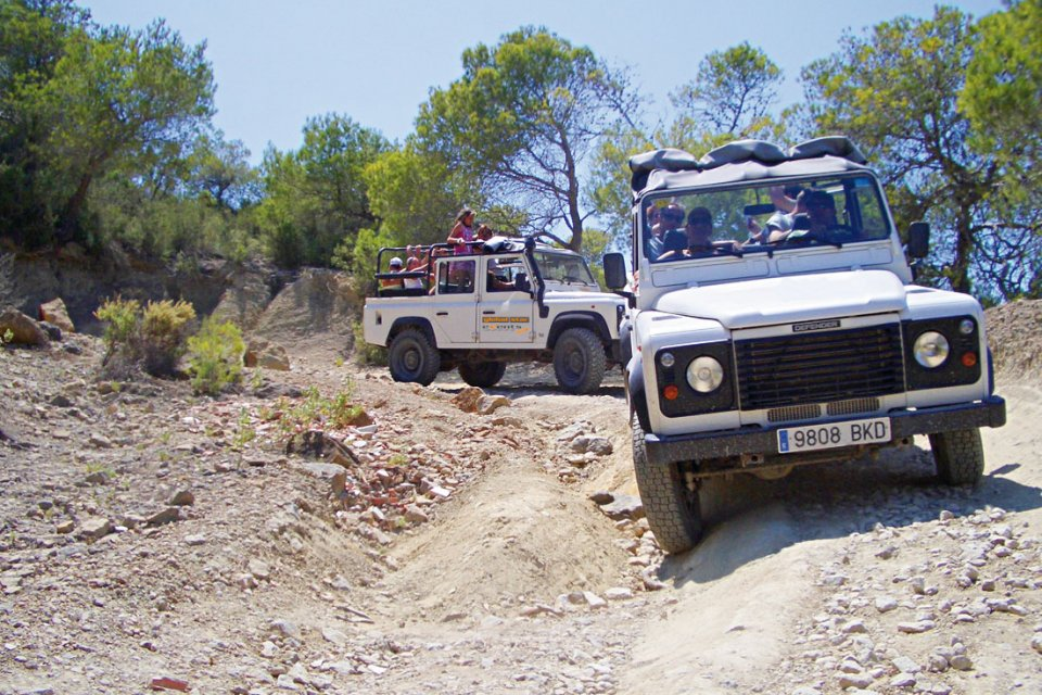 Jeeps exploring rocky trails in Ibiza