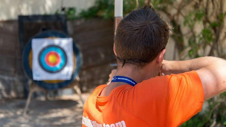 A man targeting with his bow and arrow in adventurous archery on the island.