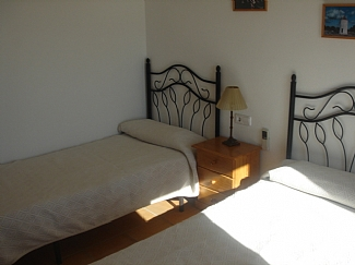 Room with two single beds in a rental house of Ibiza