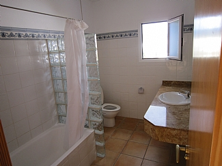 Bathroom with bath in a rental house of Ibiza