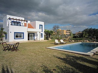 general view of a rental house with pool zone in ibiza