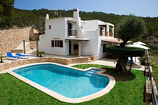 general view of the house,pool zone, garden and natural environment of Ibiza