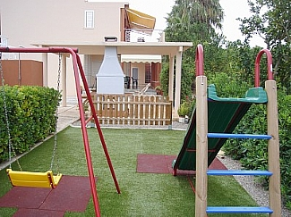 Garden zone with children's play area with swings
