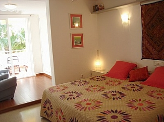 Double bed room with balcony in a house of Ibiza