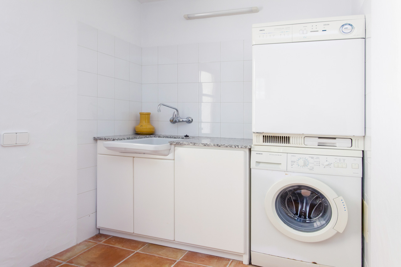 Laundry area equipped with washer and dryer