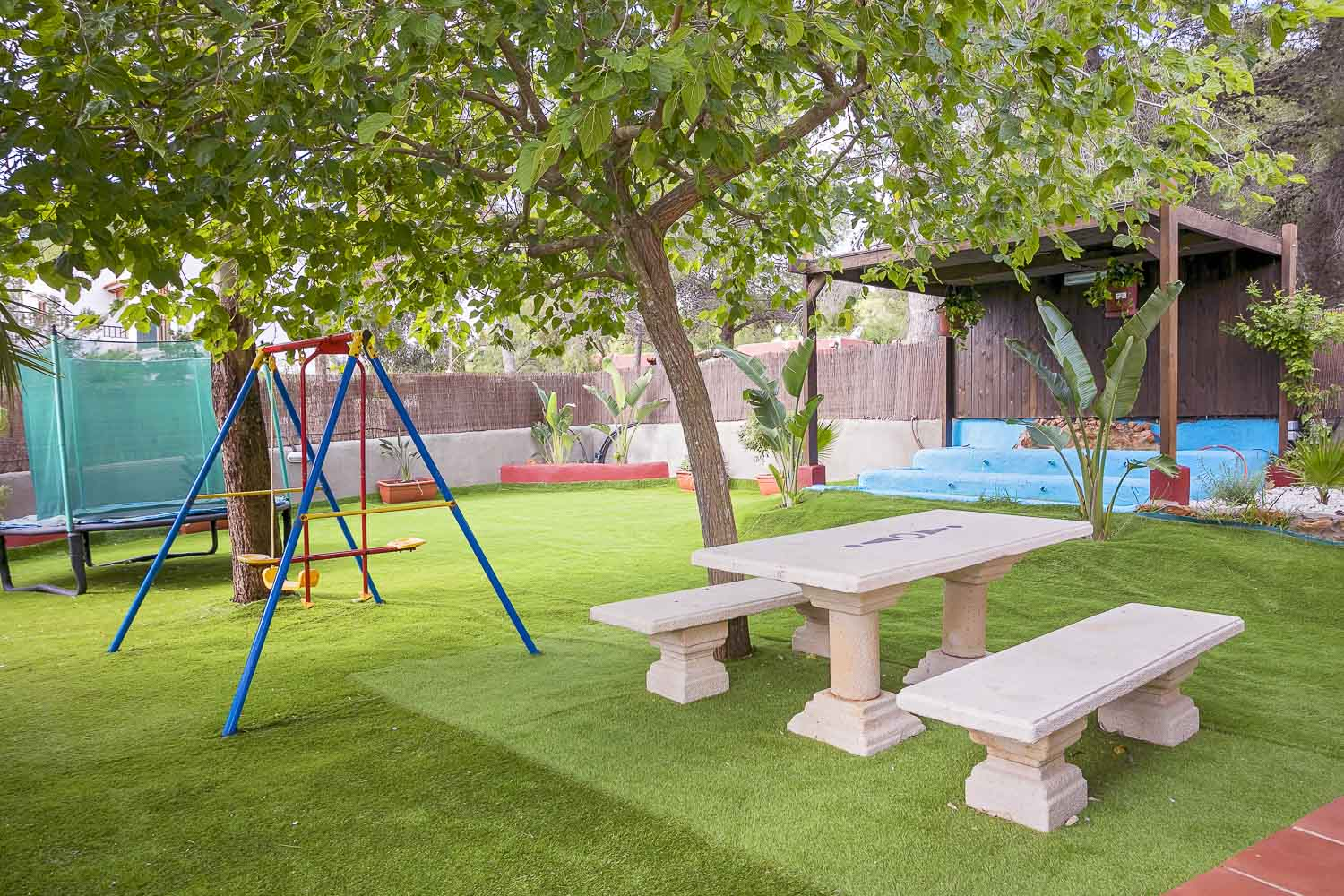 Garden with a swing in a rental house of Ibiza