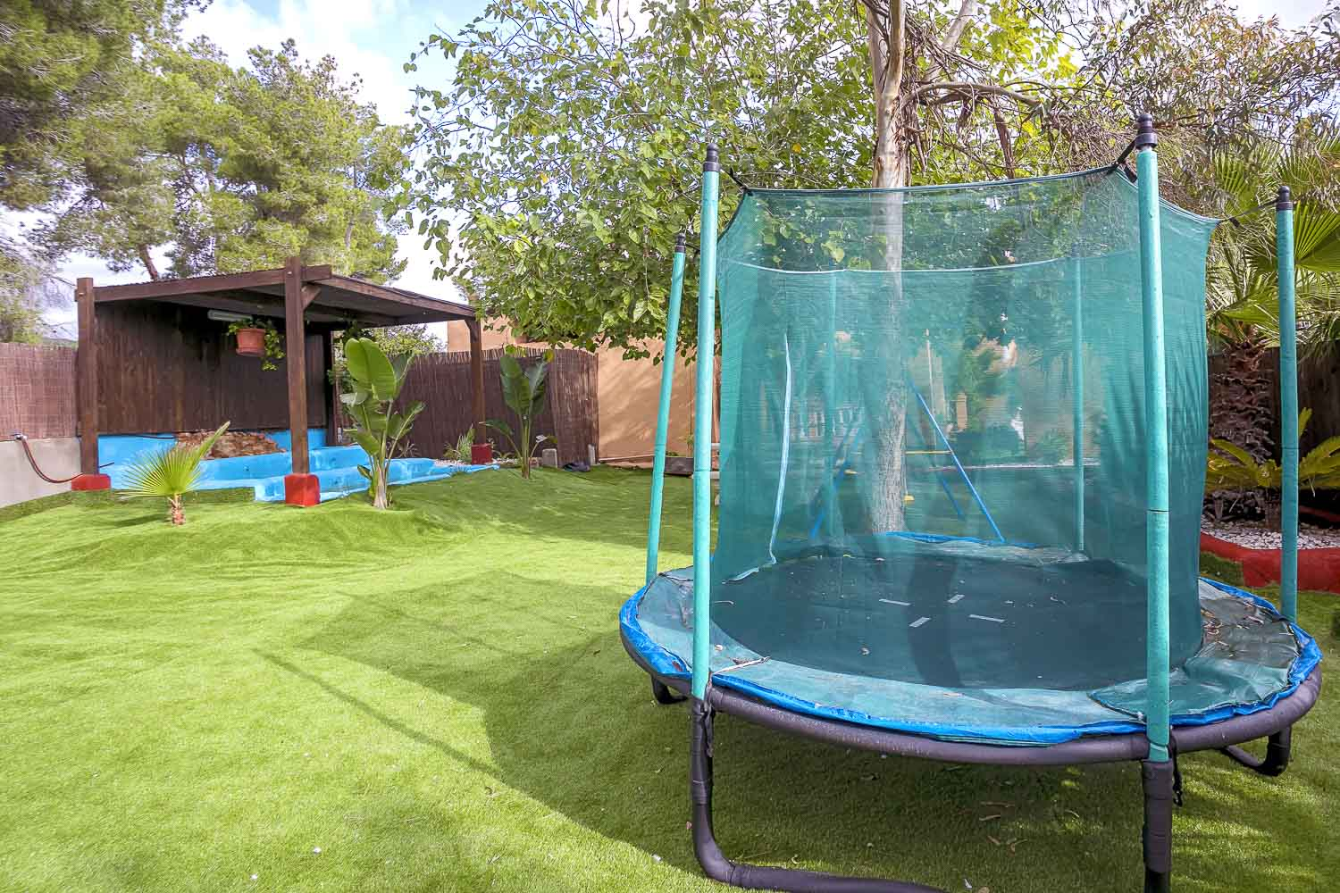 Garden with trampoline in a rental house of Ibiza