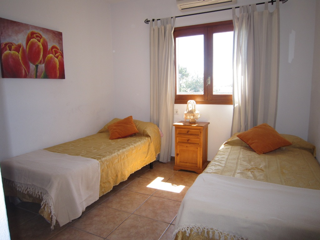 two single beds room in a house of Ibiza
