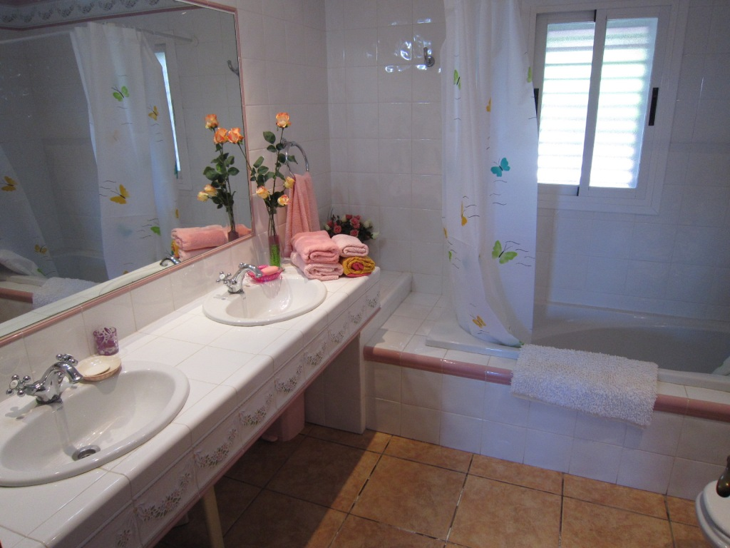 Bathroom with a bath and two sinks