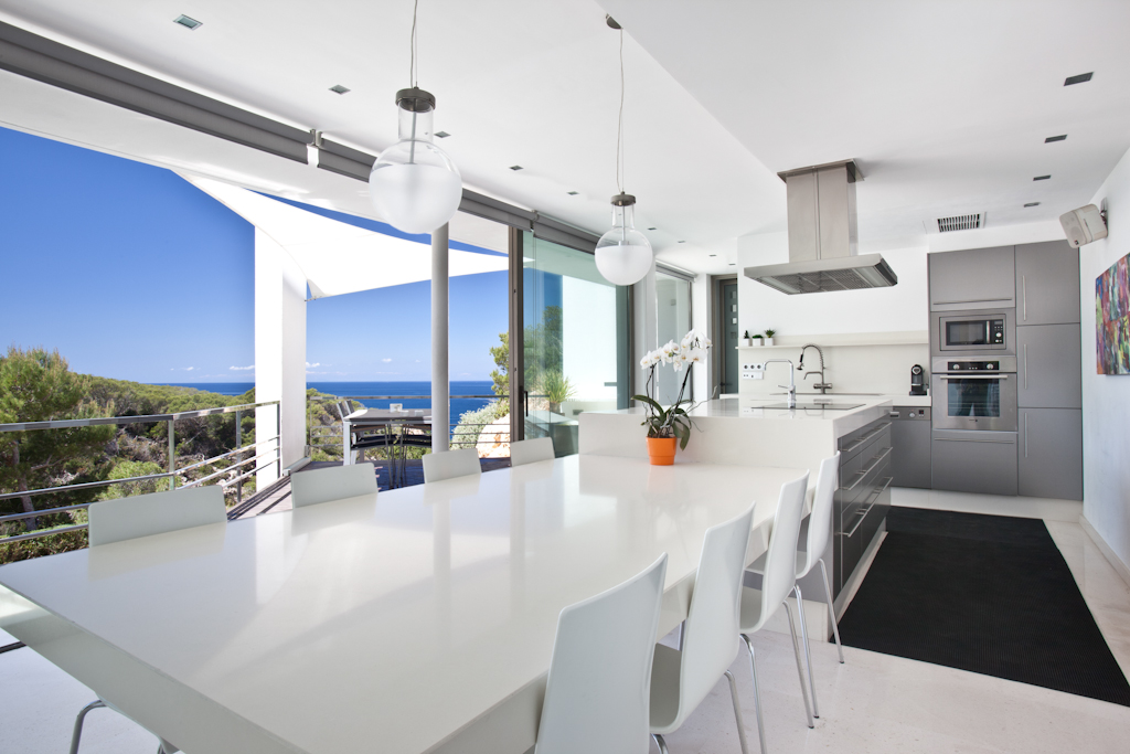 Kitchen and the dining table with views of outside the house