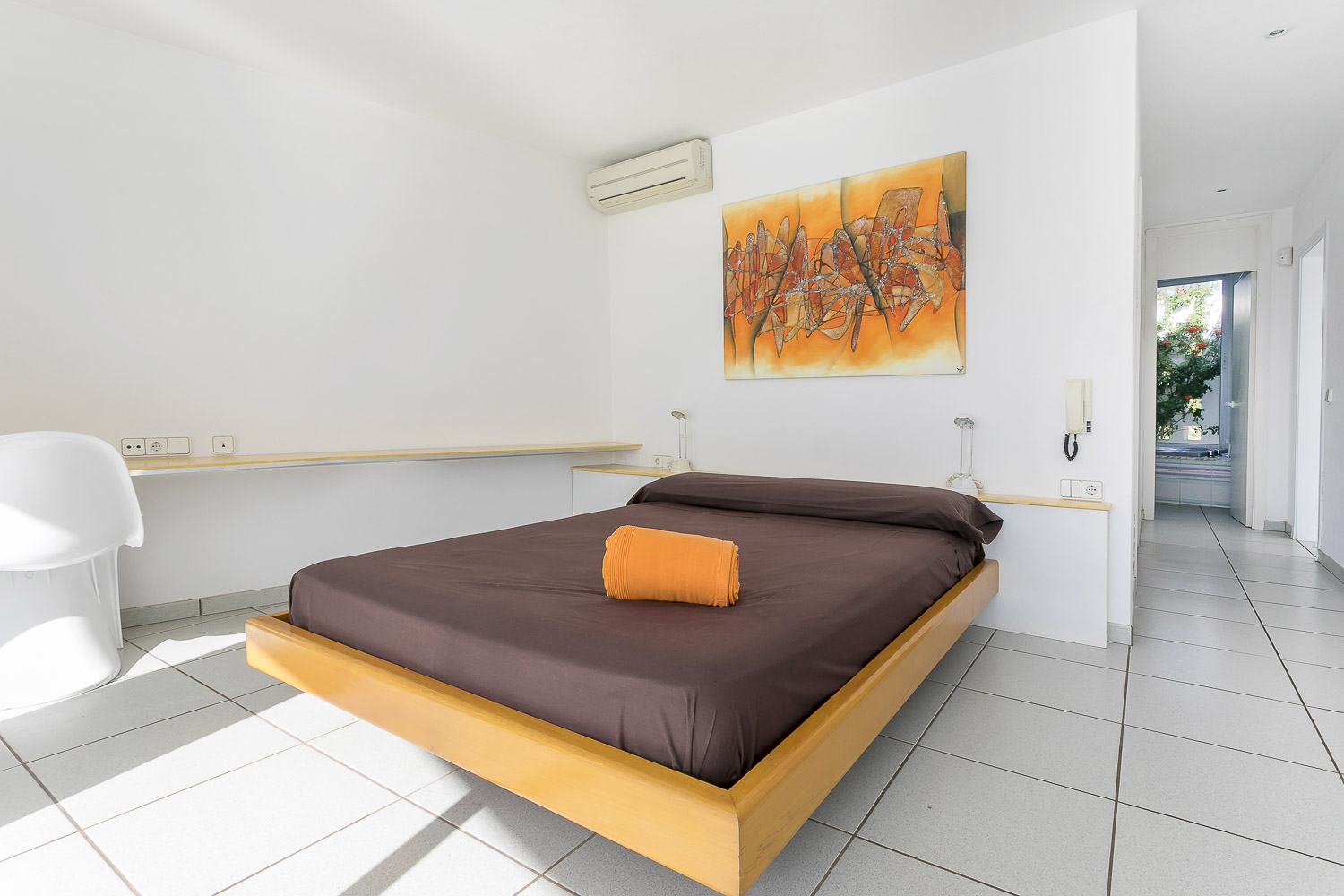 Room with large and bright double bed