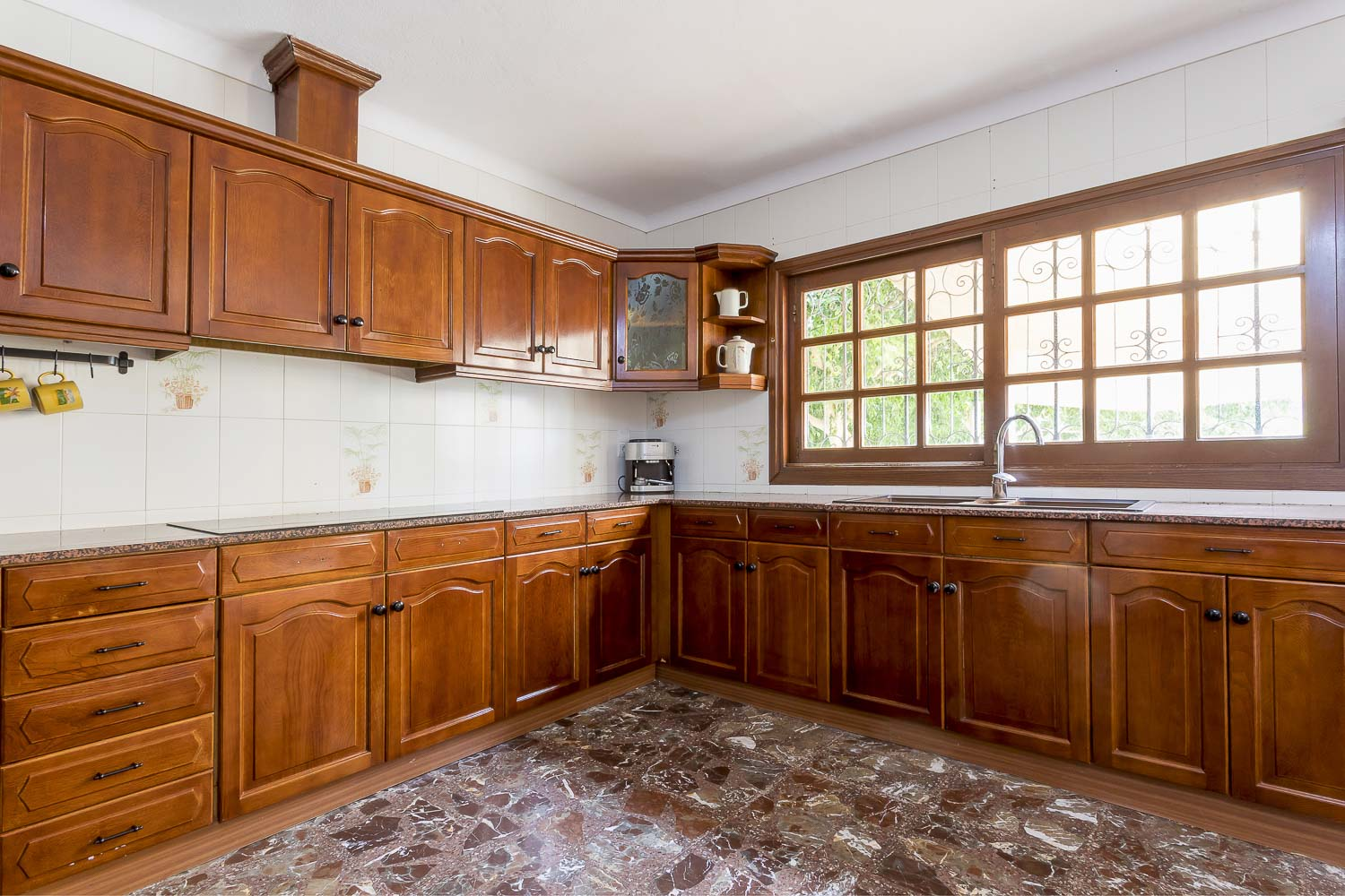 Big wood kitchen of a rental house in Ibiza