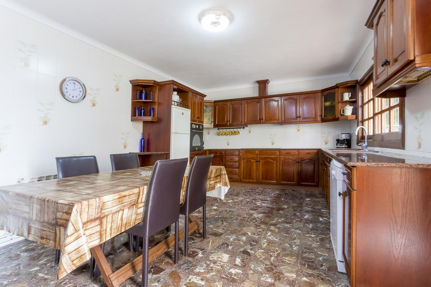Big wood kitchen with dining-table in a rental house of Ibiza