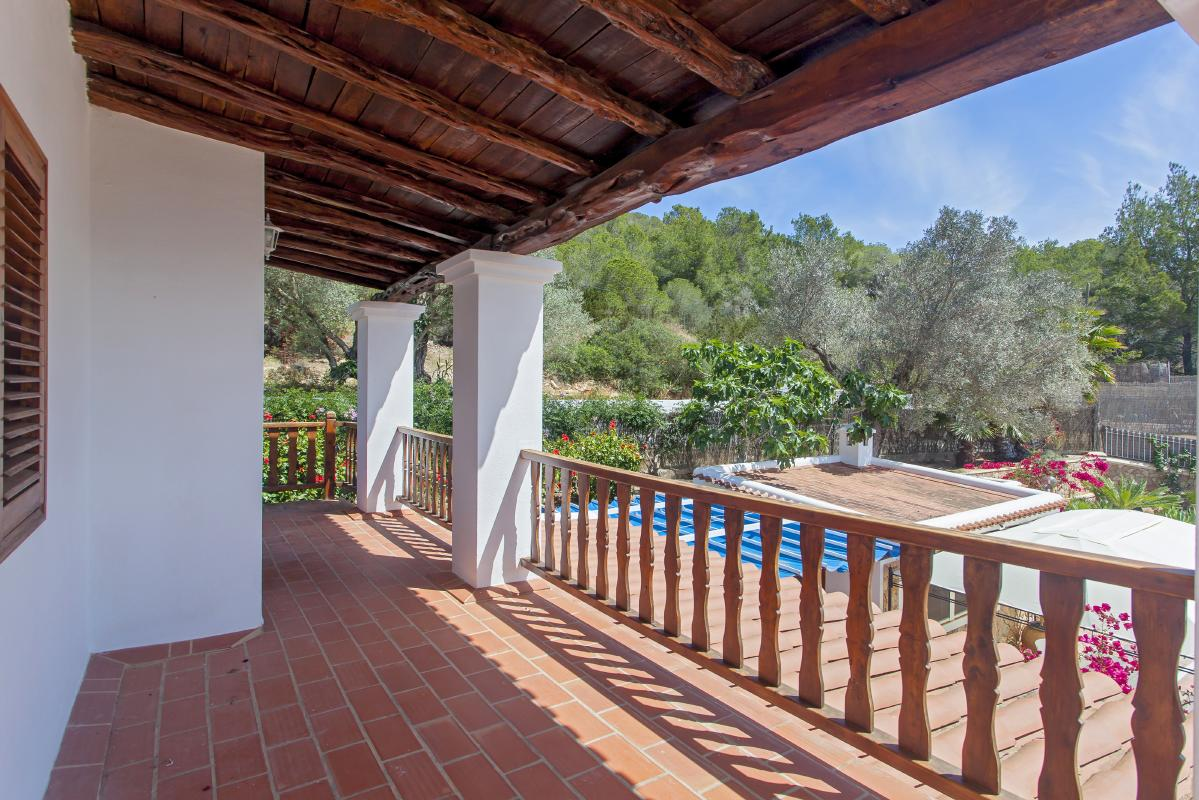 Large terrace with wooden ceilings and incredible views to the garden and pool