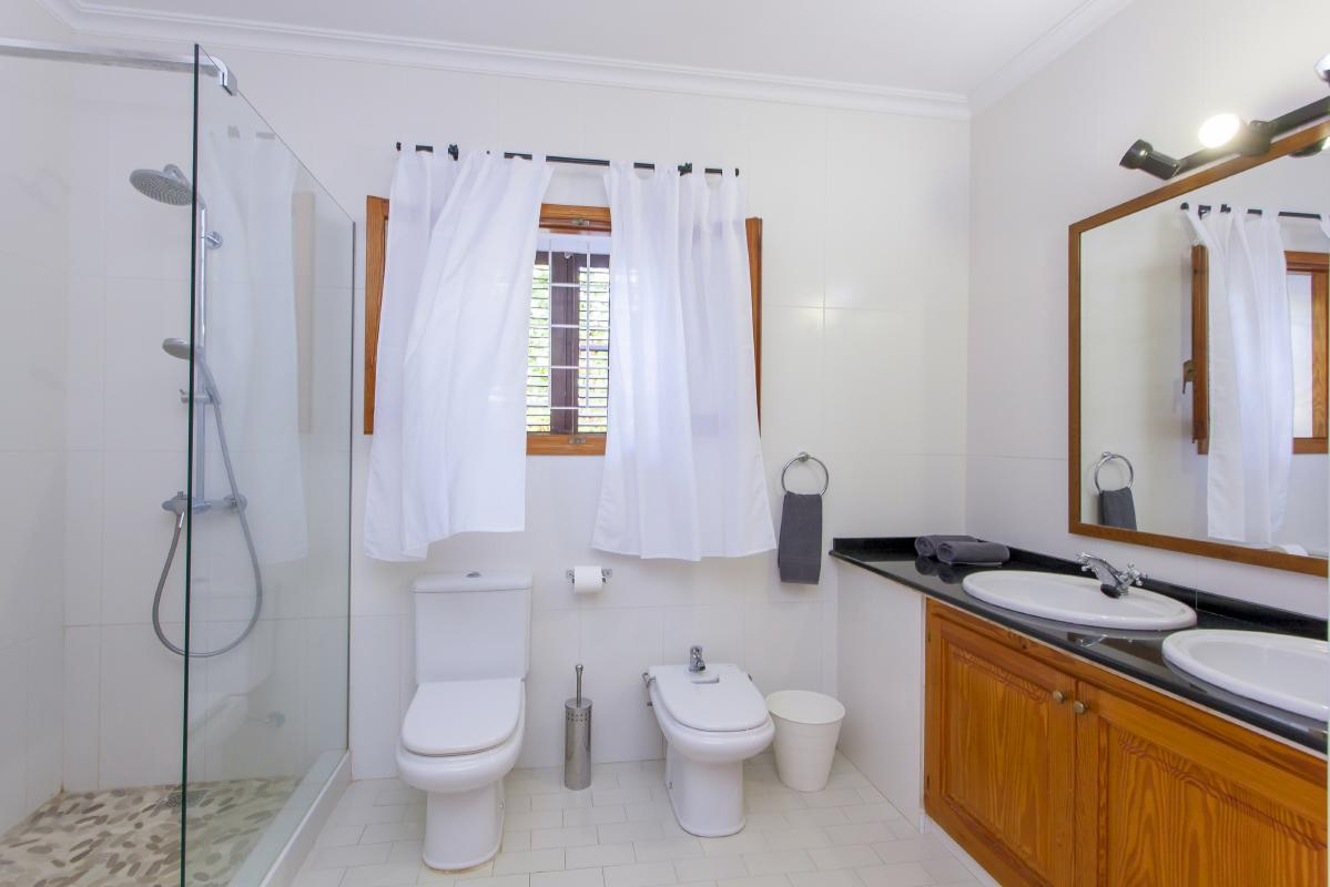 Bathroom with shower wc double washbasin and bidet