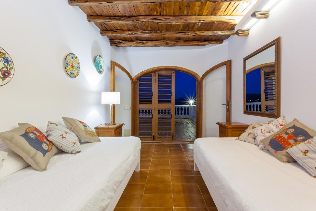 Beautiful very informal interior living room with wooden ceilings preserving the ibicenco style