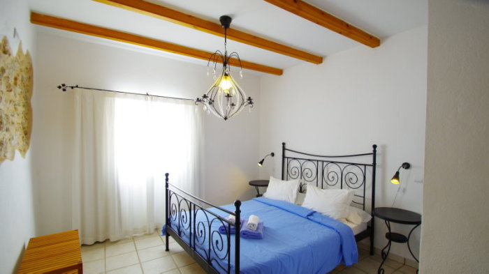 Room with a double bed in a rental house in Ibiza