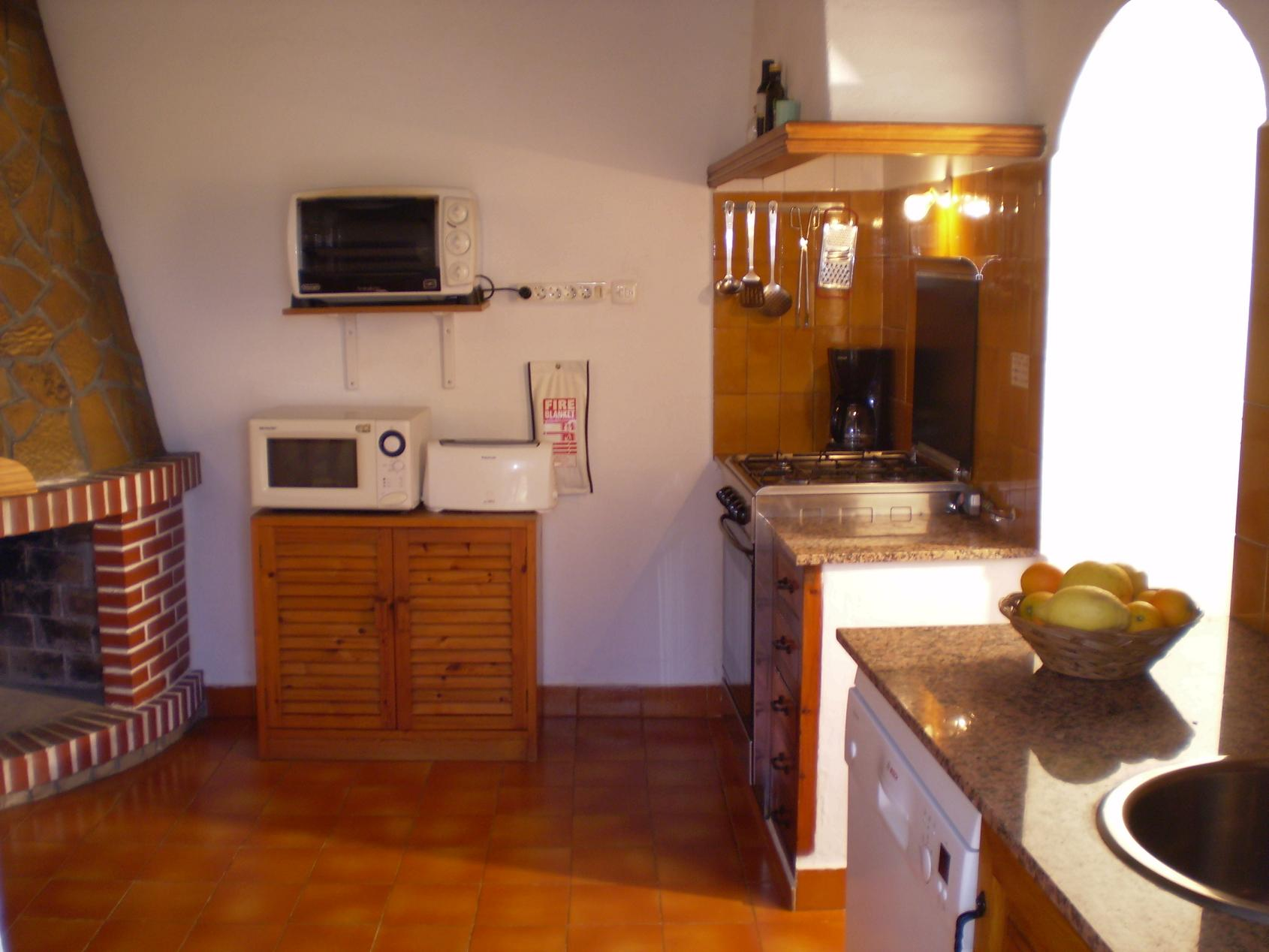 Kitchen with fireplace in a house of Ibiza