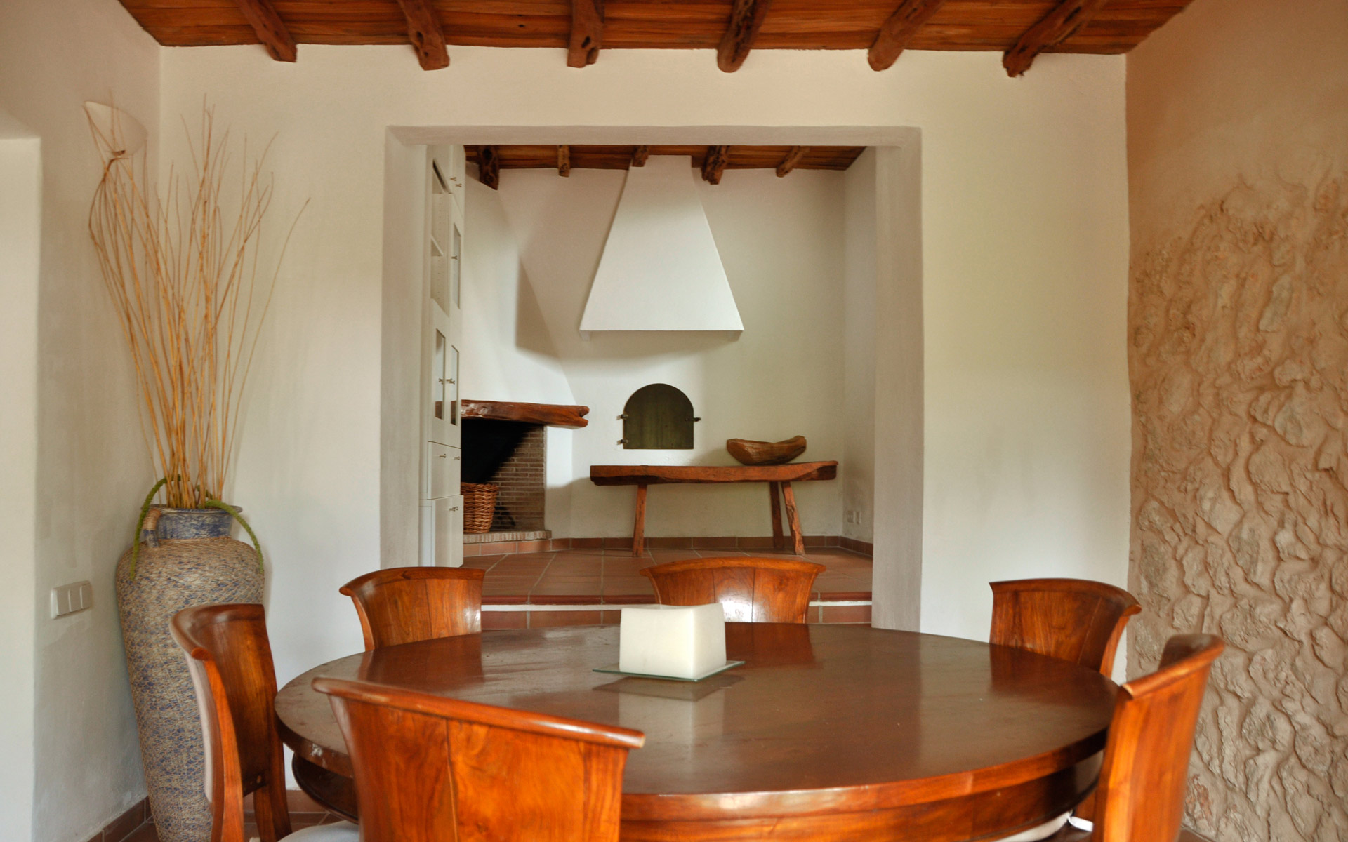 Wooden dining table room in a house of Ibiza