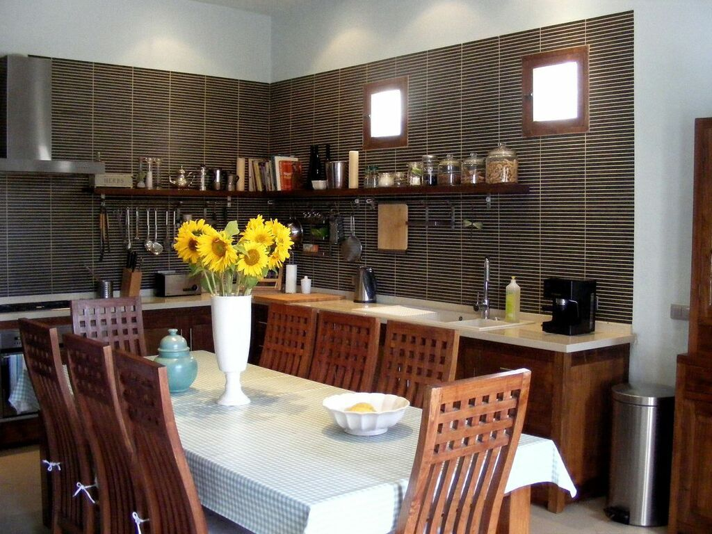 Kitchen-dining room in a rental house of Ibiza