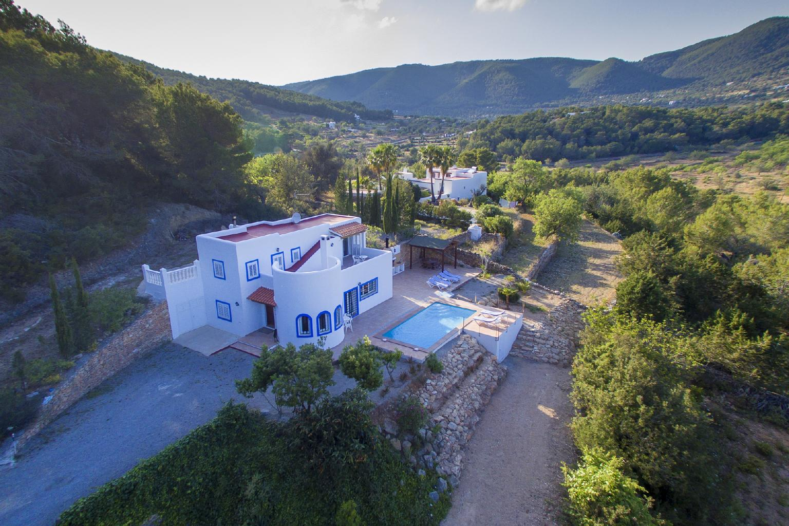Aerial view of the rental house and the natural landscape of ibiza